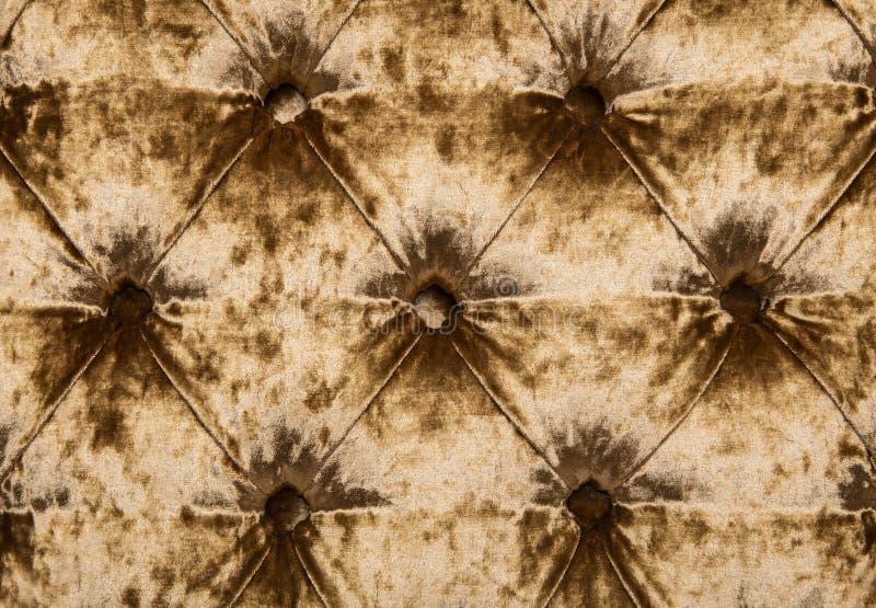 Texture tuftée de tapisserie d'ameublement de velours de capitone d'or illustration stock