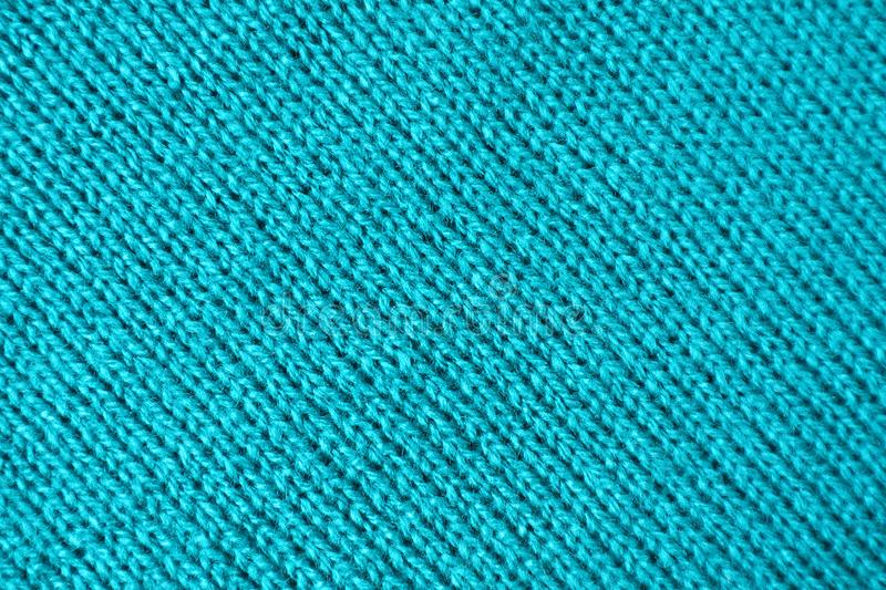 Texture of Turquoise Blue Colored Alpaca Knitted Wool Fabric in Diagonal Patterns stock images