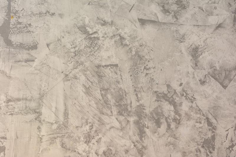 Texture of uneven plastered gray wall. Abstract light background. Putty with stains and roughness. The basis for the royalty free stock image