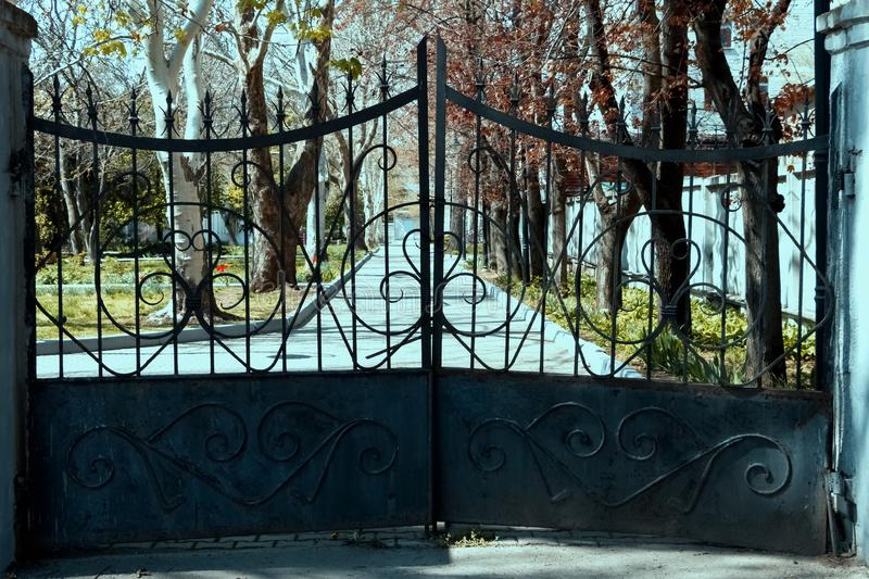 Metal, old gate to the park. stock images
