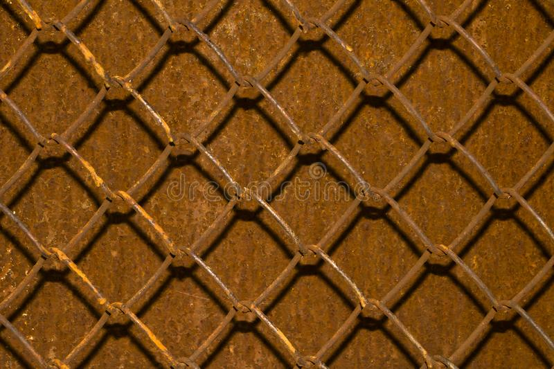 Metallic rusty grid on a blurred background of rusty metal. royalty free stock photos