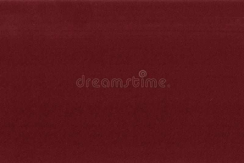 Texture of velvet or flocking red colored paper. Close up textured effect stock photography