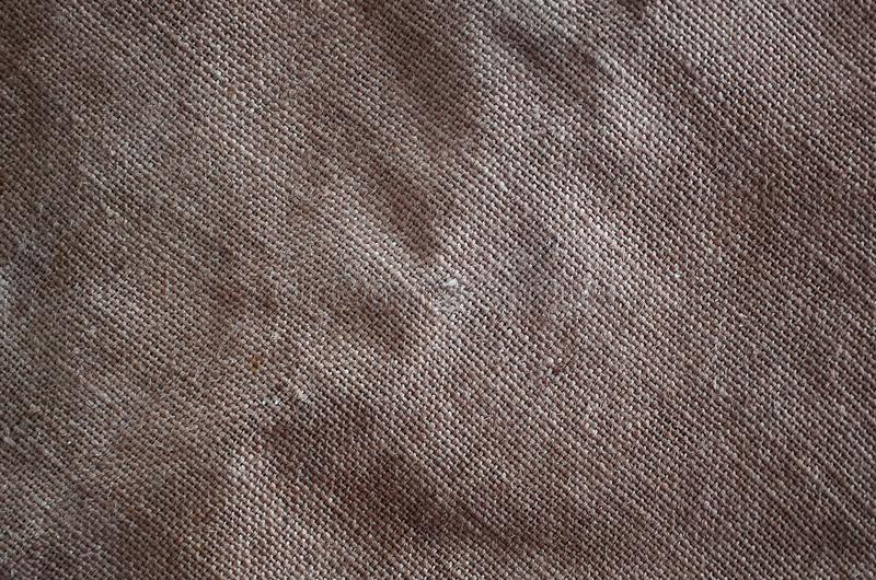 The texture of a very old brown sack cloth. Retro texture with canvas material. Background image with copy space stock images