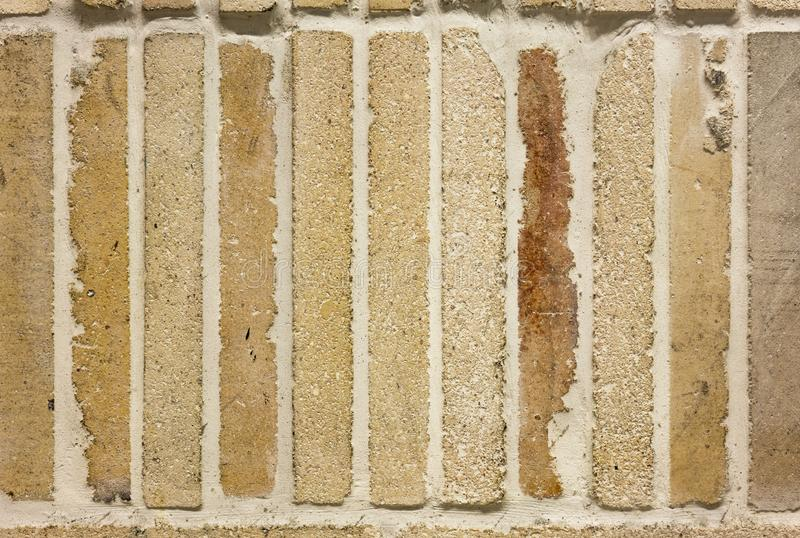 Texture of vintage brick wall background yellow stone urban surf stock images