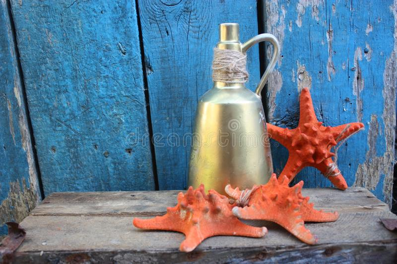 Texture Vintage glass tiles stained glassa bottle of gold ancient. Texture Vintage glass tiles stained glassa bottle of gold ancie sea still life starfish stock photography