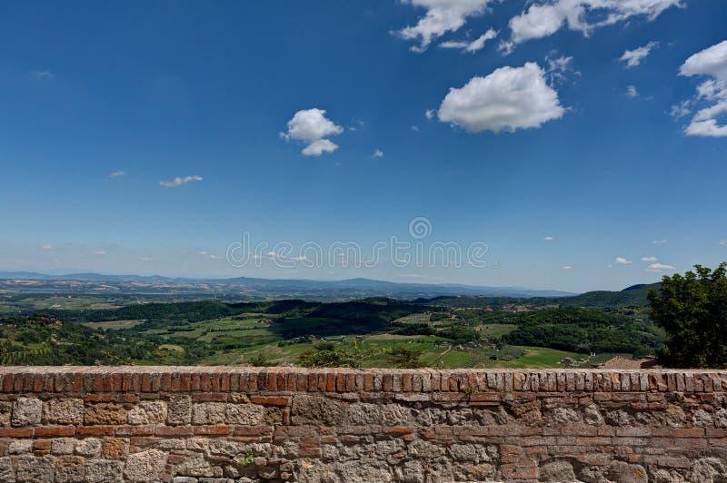 Natural Sand Stone texture wall Landscape Montepulciano, Tuscany, Toscana, Italy, Italia. Texture of a wall built with natural sand stone with raking light with royalty free stock photography