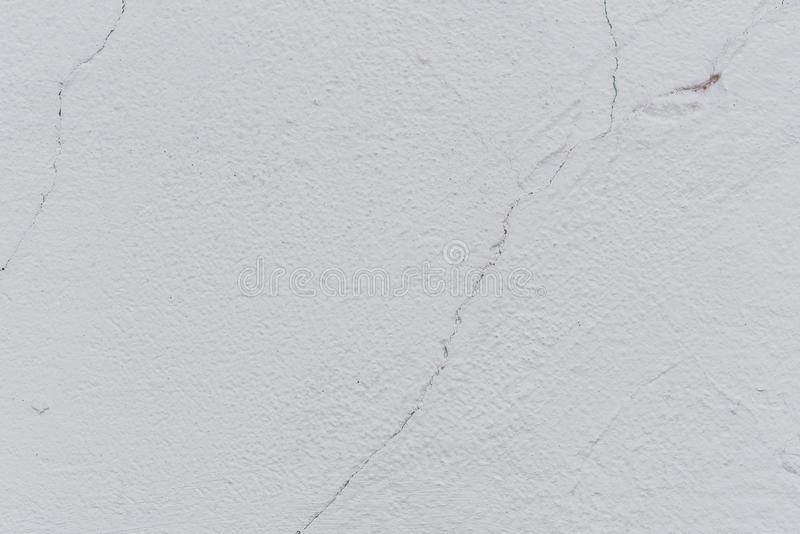 Texture of a concrete wall with cracks and scratches which can be used as a background royalty free stock image