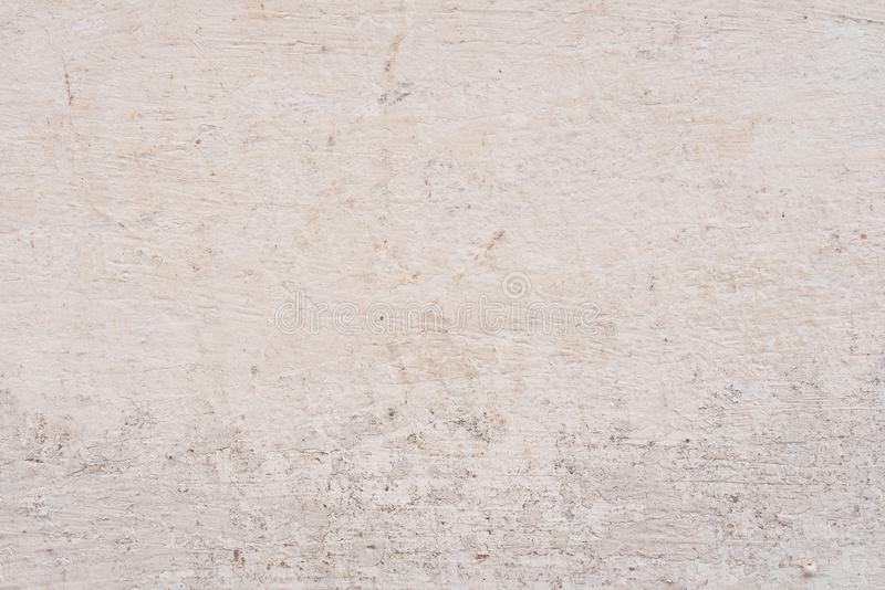 Texture of a concrete wall with cracks and scratches which can be used as a background royalty free stock photography