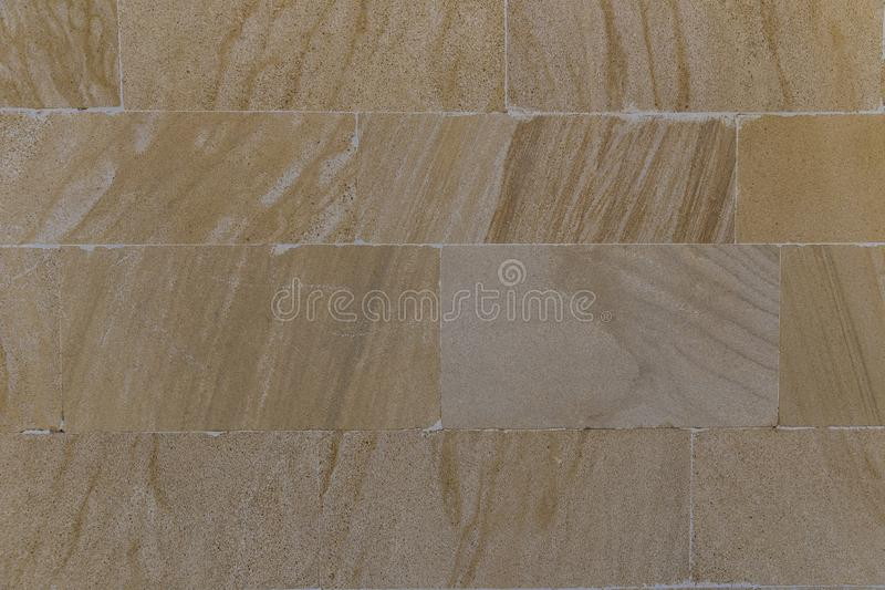 The texture of the wall lined with stone slabs royalty free stock photography