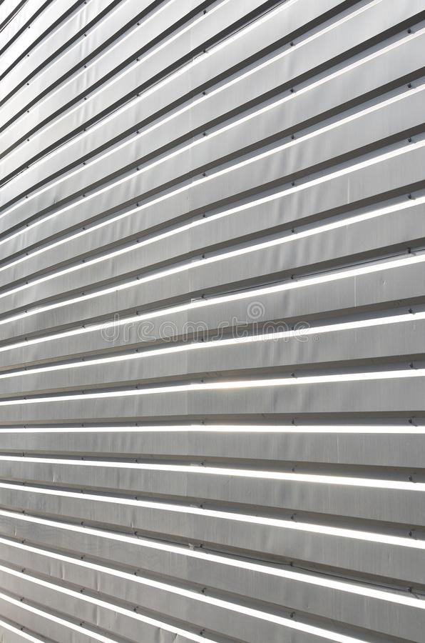 The texture of the wall is made of metal coating of huge aluminum plates of relief shape royalty free stock photography