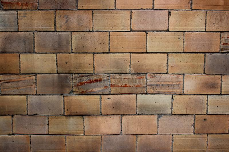 Texture of a wall from an old large yellow brick royalty free stock photos