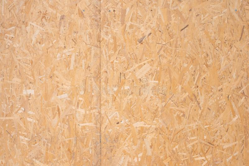 The texture of the wall of wood. The texture of pressed chips royalty free stock photography