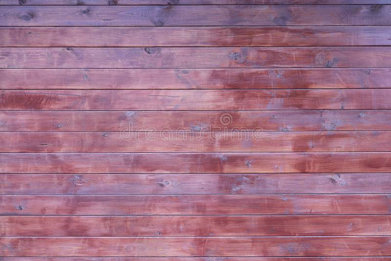 Texture wall wooden brown free background. Background of the tree, dark color boards, without objects. Billet wood horizontal. Boards wall royalty free stock photo