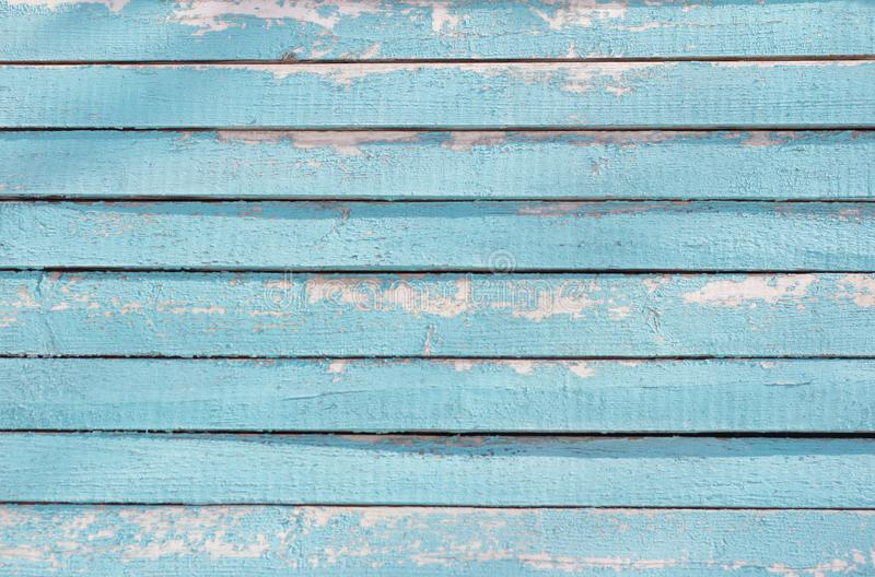 The texture of the walls of the old wooden house,blue wood background with peeling paint.  stock image