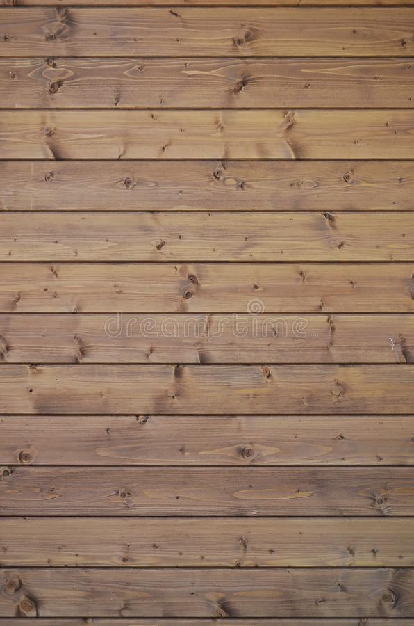 The texture of weathered wooden wall. Aged wooden plank fence of horizontal flat board stock photo