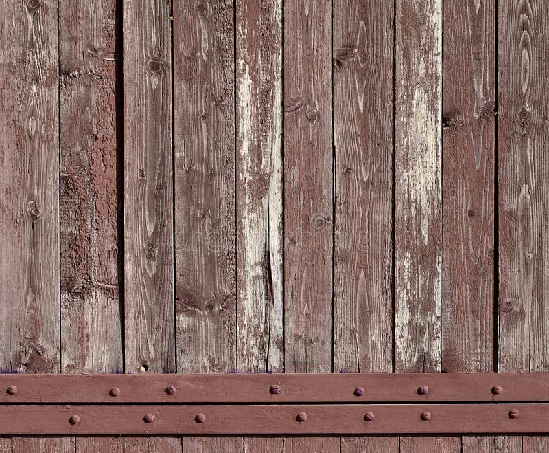 The texture of weathered wooden wall. Aged wooden plank fence of vertical flat board royalty free stock image