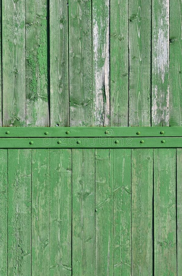 The texture of weathered wooden wall. Aged wooden plank fence of vertical flat board stock photography