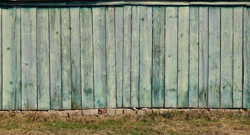 The texture of weathered wooden wall. Aged wooden plank fence of vertical flat board. S royalty free stock image