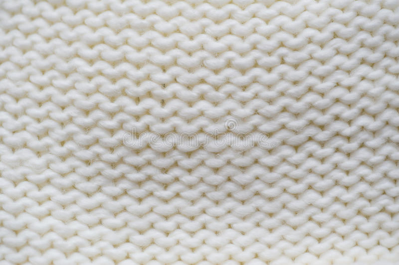 Texture of white knitted garments purl loop.  stock photography