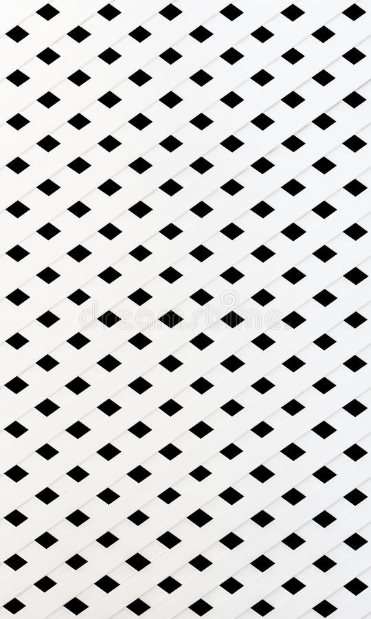 The texture of white slat wall. Isolated on black background stock image