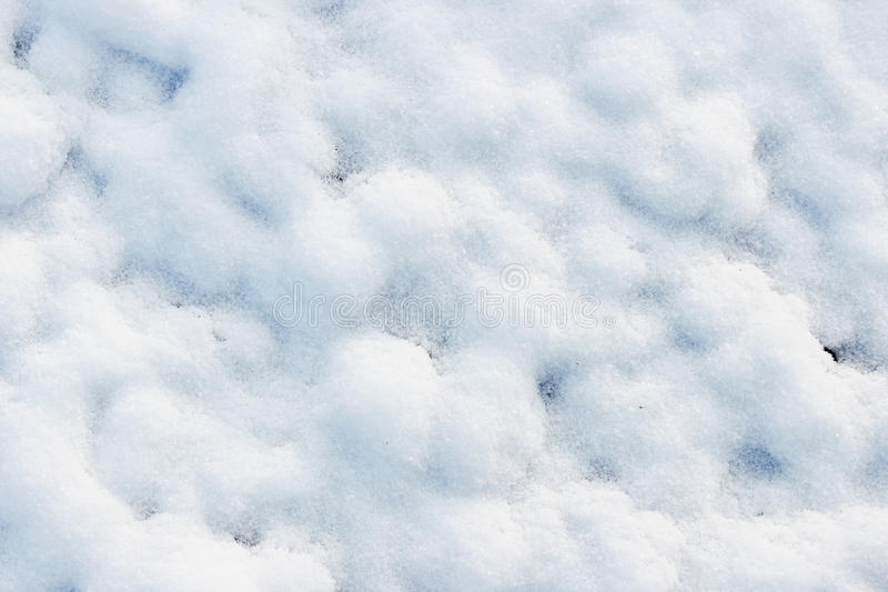 Texture of white snow like small drifts that covered the dug earth.  royalty free stock photos