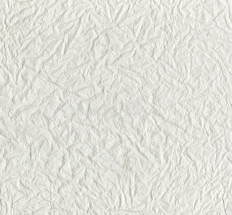 Texture of white tissue paper, background or texture. White textured WC crumpled paper with a wavy pattern. Close up of embossed crumpled pattern on paper stock images