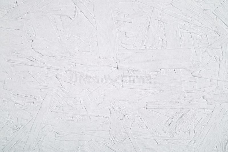 Texture of wood chipboard painted white background. Texture of large wood chipboard painted white background stock images