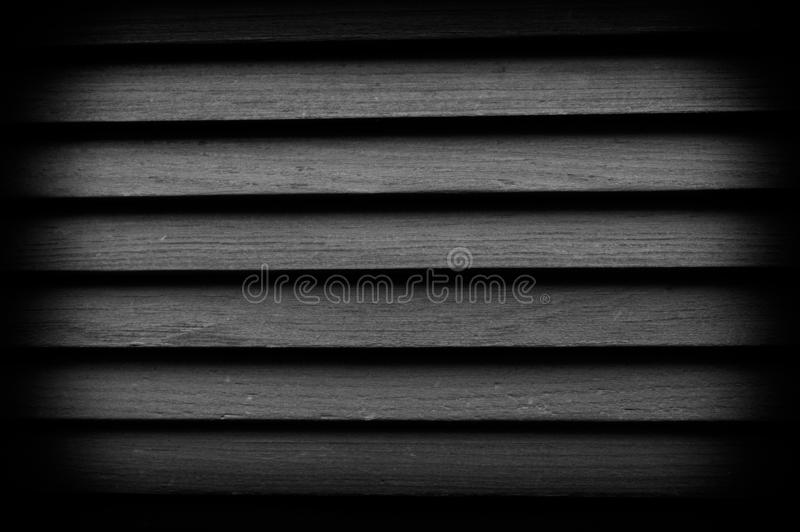 Texture of wooden blinds with vignetting. Great background for any use. Black and white photo royalty free stock images