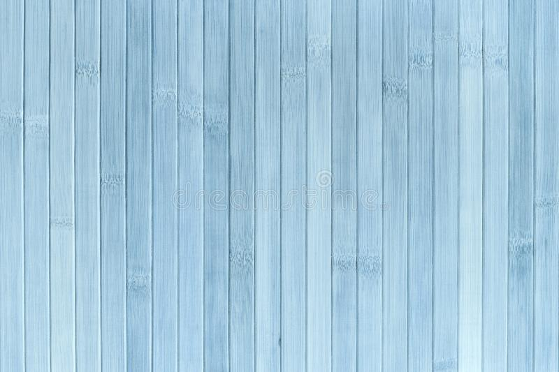 Texture of wooden light blue background. Bamboo traditional napkin for a table.  royalty free stock photography