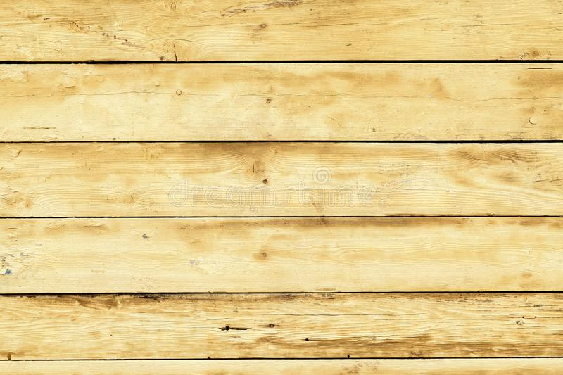 Texture of wooden planks. Yellow rustic wood for Easter and Spring backgrounds. Wood plank wall texture background royalty free stock photos