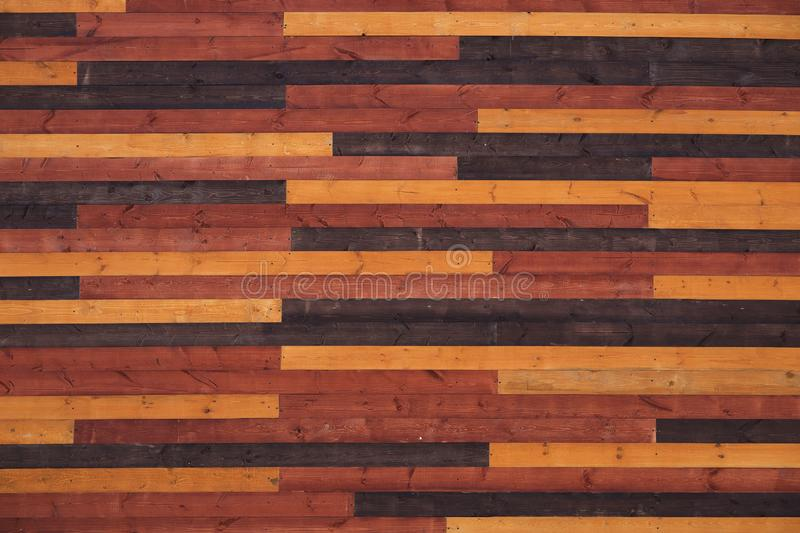 Texture of wooden slats orange brown color. Many planks on the photo royalty free stock photography