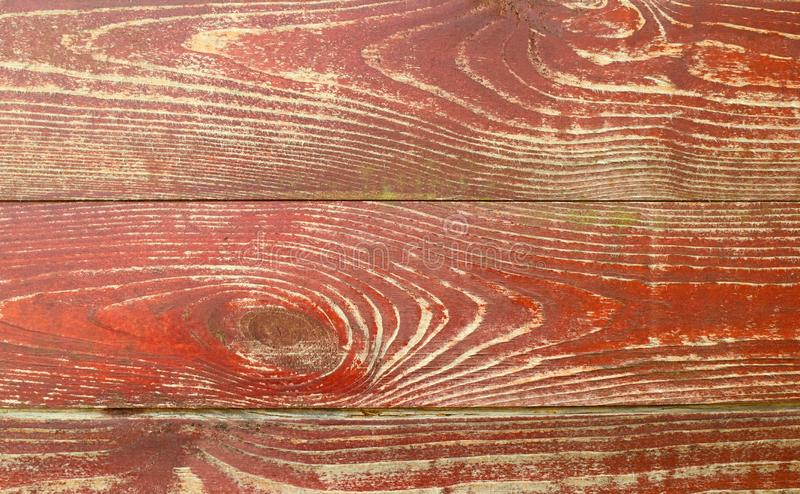 Texture of the wooden surface of an old, painted wood. Premise. Red, old background royalty free stock photography