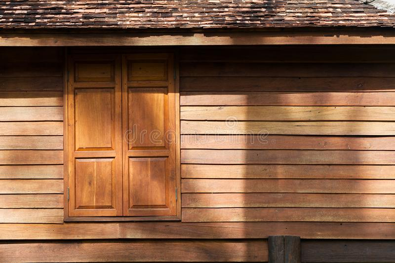 Texture of wooden wall and window of traditional thai style house stock image
