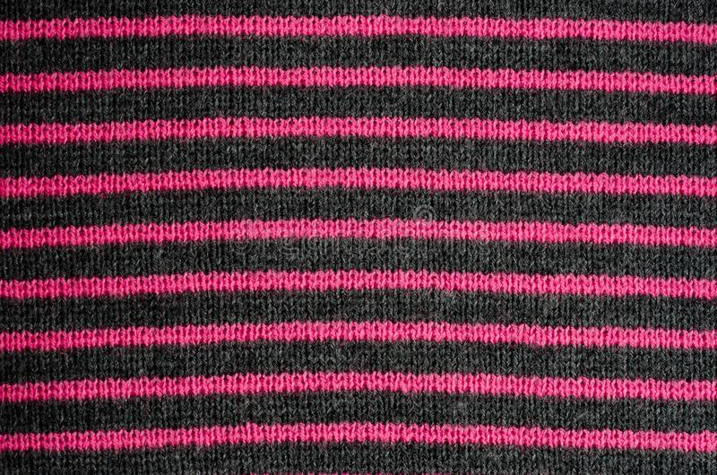 The texture of the wool fabric in black and red stripes stock photos