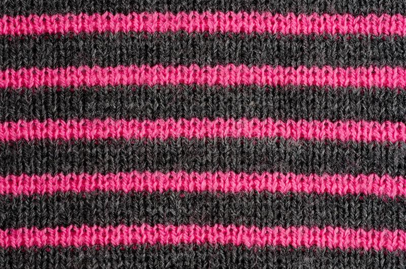 The texture of the wool fabric in black and red stripes royalty free stock photography
