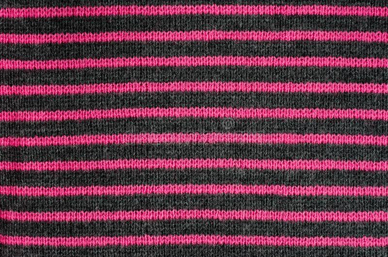 The texture of the wool fabric in black and red stripes royalty free stock photo