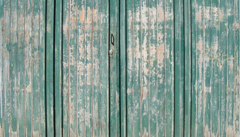Texture of worn green painted wooden garage door stock images