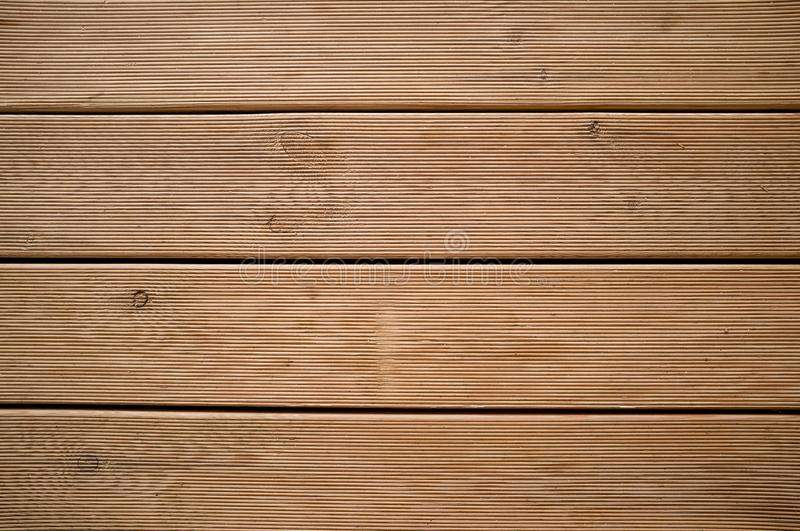 Detail of Weathered Wooden Meranti Decking royalty free stock images