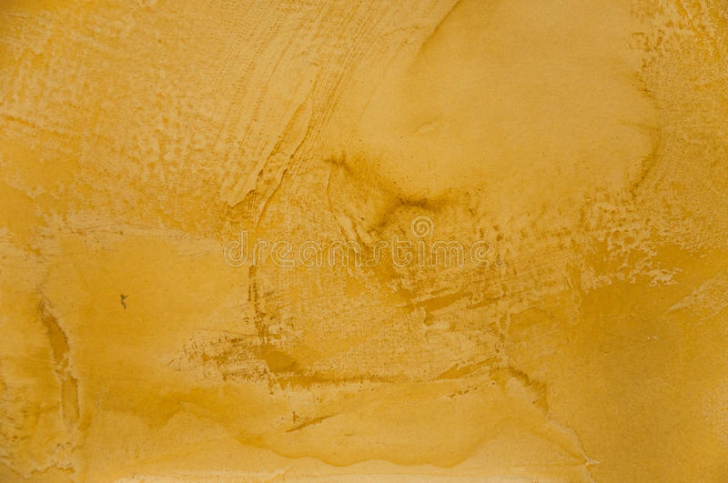 Texture of a yellow concrete as a background royalty free stock photos