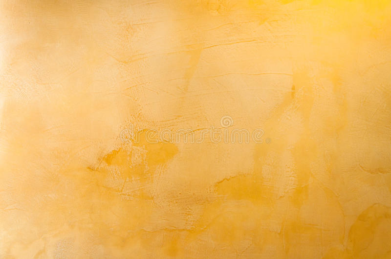 Texture of a yellow concrete as a background stock image