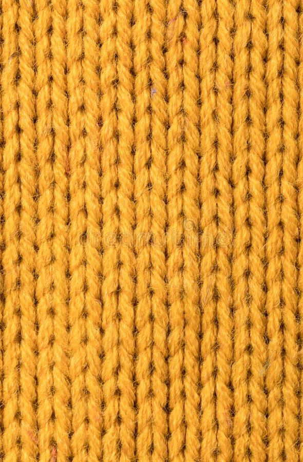 Texture of yellow sweater. Texture of warm knitted yellow sweater stock image