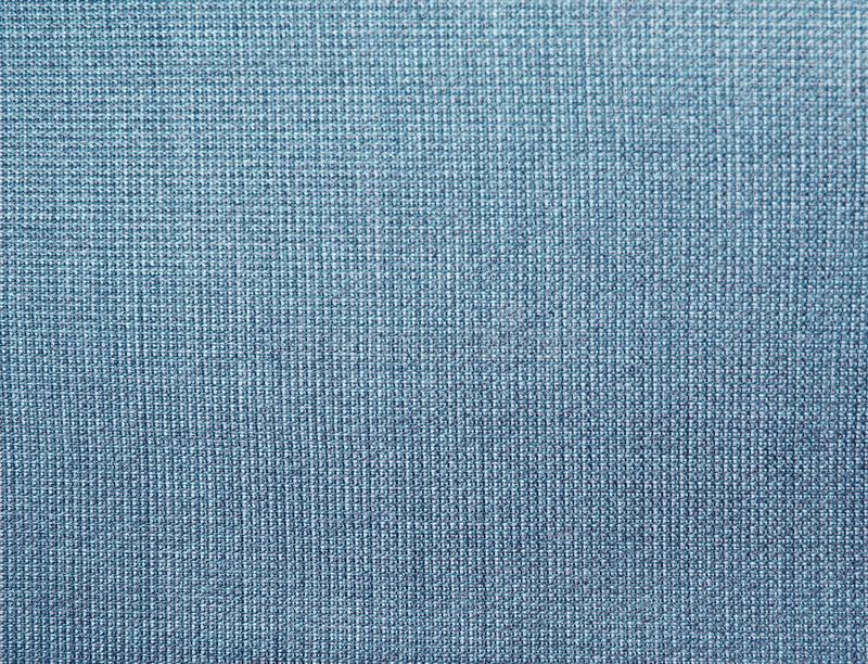 Textured background of blue natural fabric royalty free stock photos