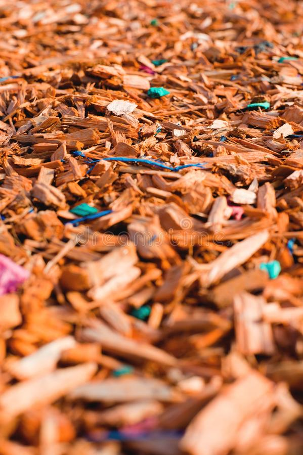 Textured background decorative colored sawdust for finishing flowerbeds in the winter season in outlook. orange, yellow royalty free stock photo