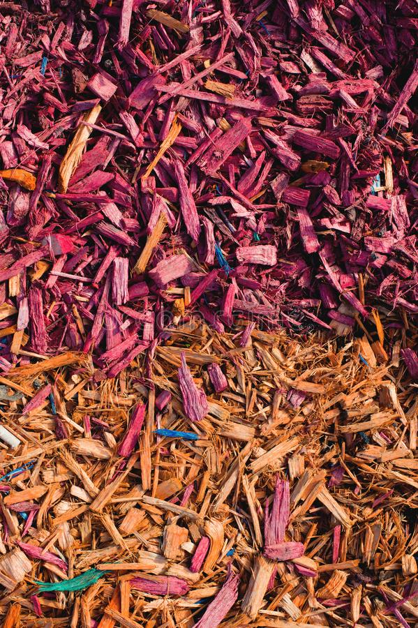 Textured background decorative colored sawdust for finishing flowerbeds in the winter season. Yellow red sawdust stock photo