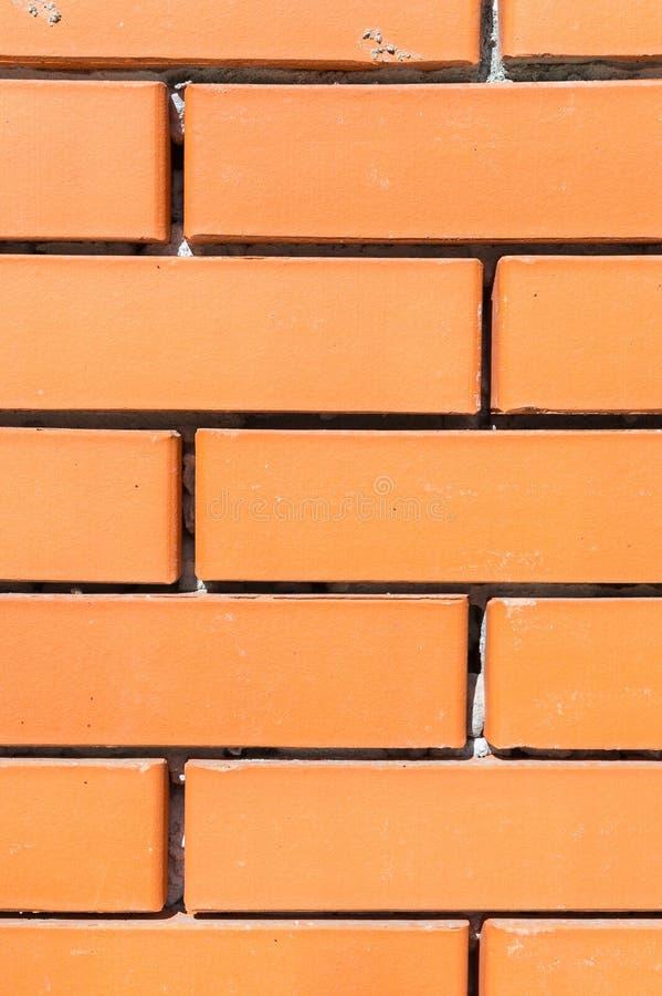 Textured background new brickwork close-up orange brick stock image