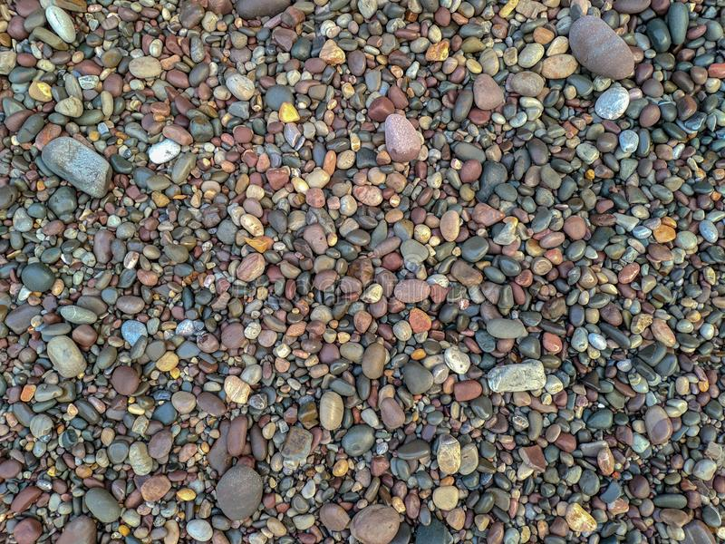 Textured background, texture of rolled river stones stock photo