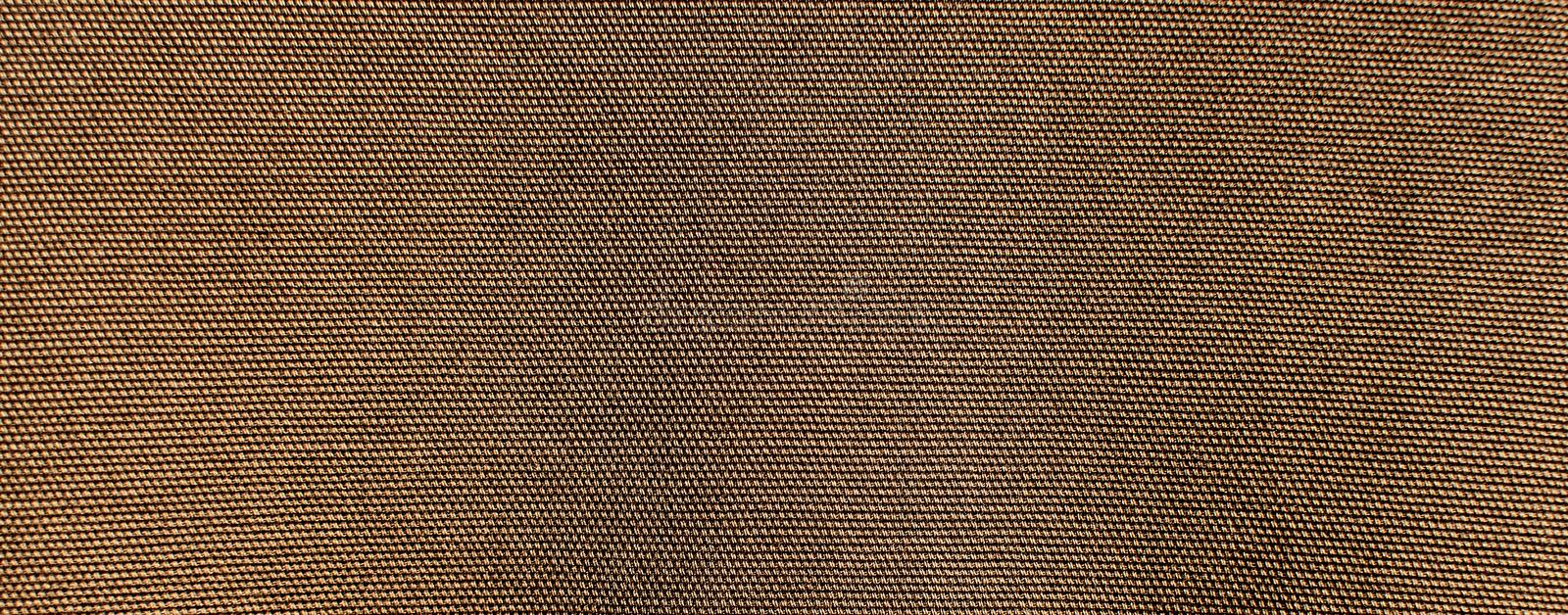 The textured background or wallpaper from rough fabric of khaki color royalty free stock photo