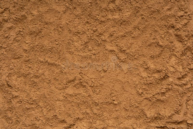 Textured backgrounds is out of sand, closeup of ground, yellow s royalty free stock photo