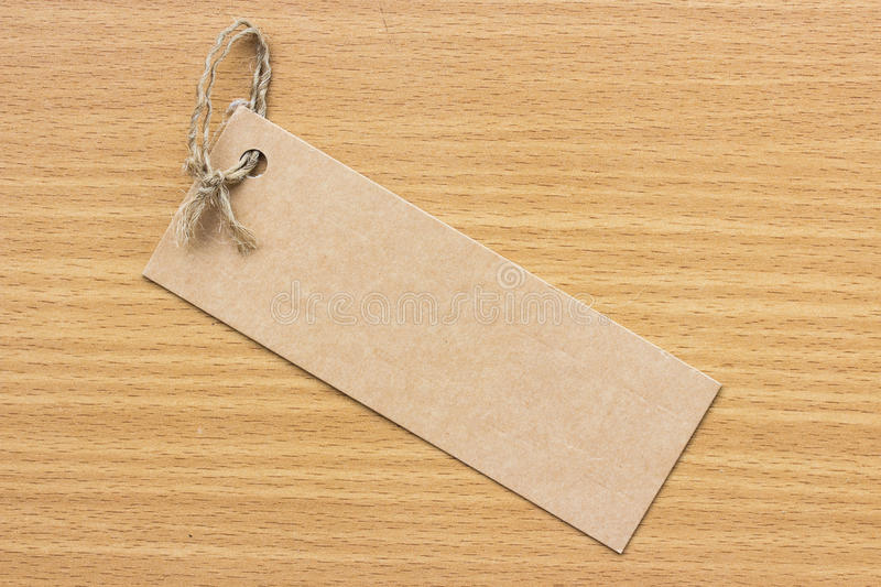 Textured blank tag tied with brown string. Price tag royalty free stock image