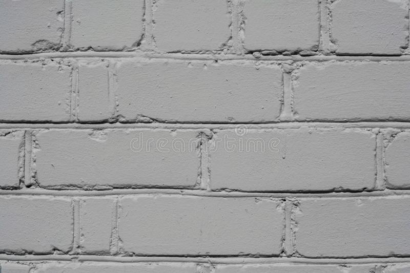Textured brick wall painted in white color, background royalty free stock photos